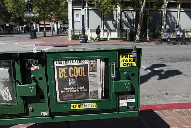 "A message to Oakland to ""Be Cool"" sits in a newspaper box moments before jurors convicted Johannes Mehserle on involuntary manslaughter on Thursday July, 8, 2010 in Oakland, Calif. Photo: Mike Kepka, The Chronicle"