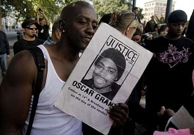 Bryan Heard, of Oakland, joins other protesters gathered at Oakland city Hal, in Oakland, Ca., in support of Oscar Grant, after former BART police officer, Johannes Mehserle was found guilty of involuntary man slaughterr in the killing of Grant today. Photo: Michael Macor, The Chronicle