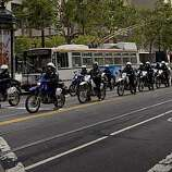Increased police presence was noticeable as they patroled Market Street near the BART stations in San Francisco, Calif., in preparation for possible rioting in response to the Mehserle verdict on Thursday, July 8, 2010.