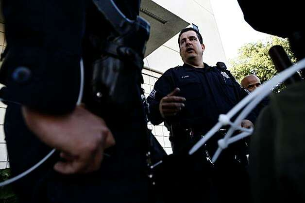 Sergeant John Lois briefs his squad from the Internal Affairs Division on hand signals while waiting on stand-by at the Emergency Operations Center following the Johannes Mehserle verdict on Thursday, July 8, 2010 in Oakland, Calif. Photo: John Sebastian Russo, The Chronicle