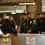 Police officers prepare for an angry crowd at the Fruitvale BART station after the announcement that former BART police officer Johannes Mehserle was found guilty of involuntary manslaughter in the shooting death of Oscar Grant, Thursday July 8, 2010, in Oakland, Calif.  Calif.