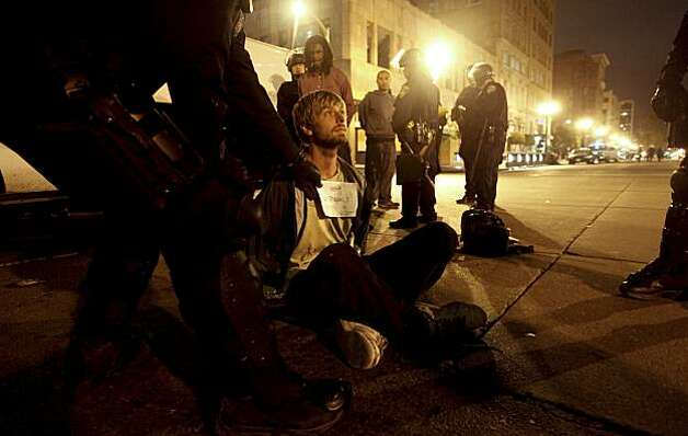Sam Whitman is processed on the scene after being arrested during the protest in downtown Oakland, Ca., on Thursday July 8, 2010,  in support of Oscar Grant, after former BART police officer, Johannes Meserle, was found guilty of involuntary man slaughter in the killing of Grant. Photo: Michael Macor, The Chronicle