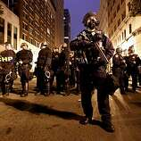 CHP officers secure the area around Broadway and Telegraph as protesters gathered in downtown Oakland, Ca., on Thursday July 8, 2010, in support of Oscar Grant, after former BART police officer, Johannes Mehserle, was found guilty of involuntary man slaughter in the killing of Grant.