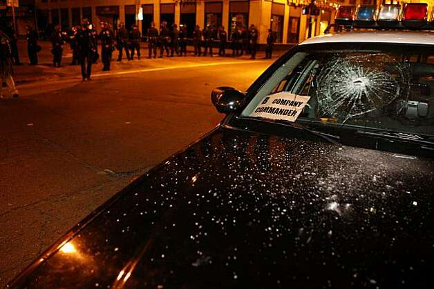 Police attempt to push back crowds after a demonstrator smashed the window of a Highway Patrol cruiser on Broadway Street following the Johannes Mehserle verdict on Thursday, July 8, 2010 in Oakland, Calif. Photo: John Sebastian Russo, The Chronicle