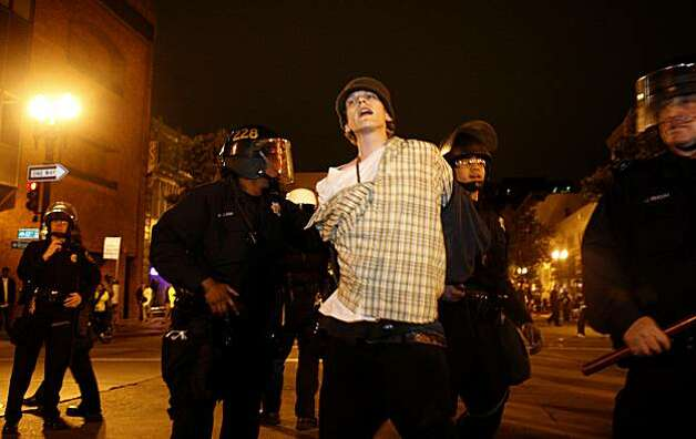 The police arrest a young man on 17th and Broadway after attempts disperse crowds of demonstrators became tense following the Johannes Mehserle verdict on Thursday, July 8, 2010 in Oakland, Calif. Photo: John Sebastian Russo, The Chronicle
