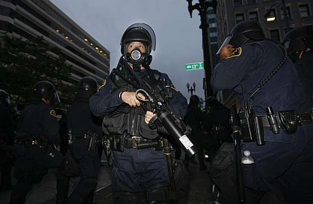 Police use gas masks for crowd control, as protesters gathered in downtown Oakland, Ca., on Thursday July 8, 2010,  in support of Oscar Grant, after former BART police officer, Johannes Mehserle, was found guilty of involuntary man slaughter in the killing of Grant. Photo: Michael Macor, The Chronicle