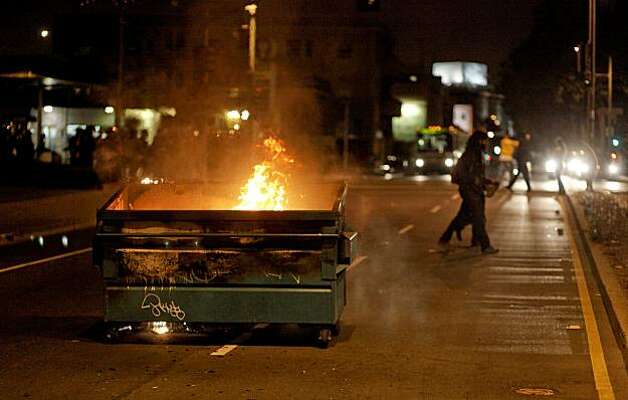 Protesters torched several dumpsters, this one near the corner of Telegraph and West Grand Ave., in downtown Oakland, Ca., on Thursday July 8, 2010,  in support of Oscar Grant, after former BART police officer, Johannes Mehserle, was found guilty of involuntary man slaughter in the killing of Grant. Photo: Michael Macor, The Chronicle
