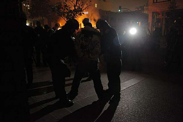 The Oakland police arrest people as they riot through the streets of Oakland, Calif. Thursday July 8, 2010 after hearing the verdict in the shooting of Oscar Grant. Former BART police officer Johannes Mehserle was found guilty for involuntary manslaughter in the killing of Grant. Photo: Lacy Atkins, The Chronicle