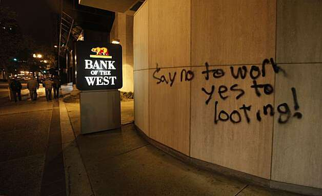 Protesters left behind graffiti on the Bank of the West building along Broadway in downtown in Oakland, Ca., on Thursday July 8, 2010,  in support of Oscar Grant, after former BART police officer, Johannes Mehserle, was found guilty of involuntary man slaughter in the killing of Grant. Photo: Michael Macor, The Chronicle