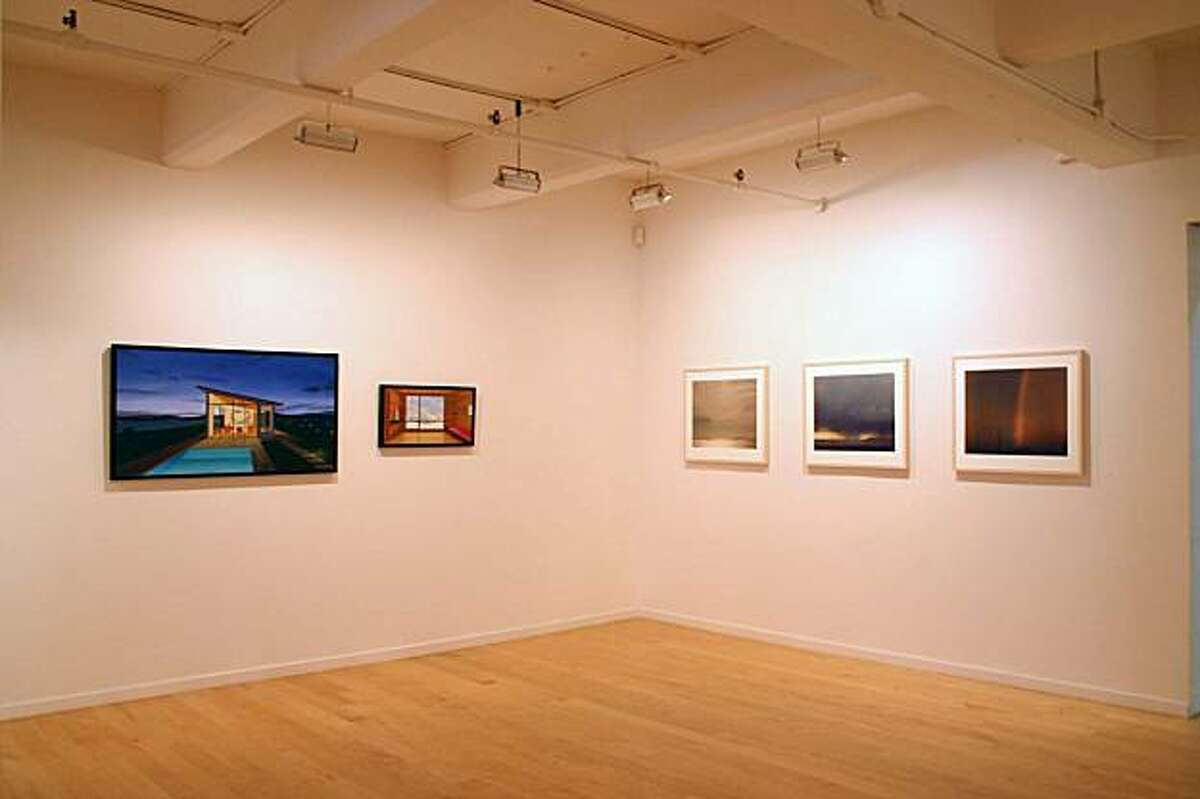"""Installation view of """"They Knew What They Wanted"""" at John Berggruen Gallery showing paintings by Tom McKinley (left wall) and photographs by Richard Misrach (right) works selected by Robert Bechtle"""