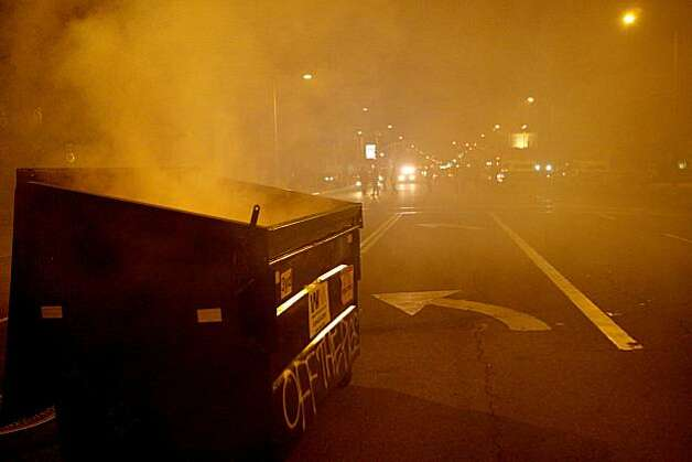 A dumpster is left smoking in the middle of Telegraph Avenue after demonstrator dispersed following the Johannes Mehserle verdict on Thursday, July 8, 2010 in Oakland, Calif. Photo: John Sebastian Russo, The Chronicle