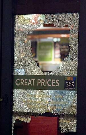 Protesters smashed several windows at Whole Foods Market on Harrison Street in Oakland, Calif. on Thursday, July 8, 2010.  The reaction to former BART officer Johannes Mehserle's conviction of involuntary manslaughter for the shooting death of Oscar Grant turned destructive after dark.    Kat Wade / Special to the Chronicle Photo: Kat Wade, Special To The Chronicle