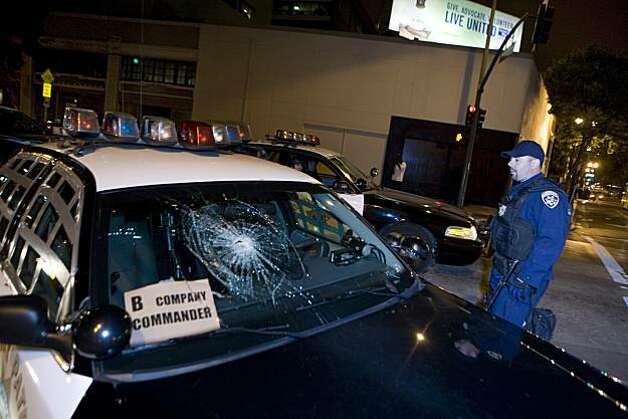 According to California Highway Patrol Officers a protester used a hammer to smash the window of the  B company commander's car during protests over former BART officer Johannes Mehserle's conviction of involuntary manslaughter for the shooting death of Oscar Grant in Oakland, Calif. on Thursday, July 8, 2010.   Kat Wade / Special to the Chronicle Photo: Kat Wade, Special To The Chronicle