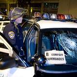 According to California Highway Patrol Officers a protester used a hammer to smash the window of the  B company commander's car during protests over former BART officer Johannes Mehserle's conviction of involuntary manslaughter for the shooting death of Oscar Grant in Oakland, Calif. on Thursday, July 8, 2010.   Kat Wade / Special to the Chronicle