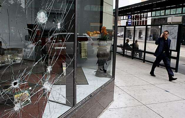 A Sears corner window displays evidence of vandalism following Thursday's demonstrations on Broadway over the Johannes Mehserle conviction. Photo: John Sebastian Russo, The Chronicle