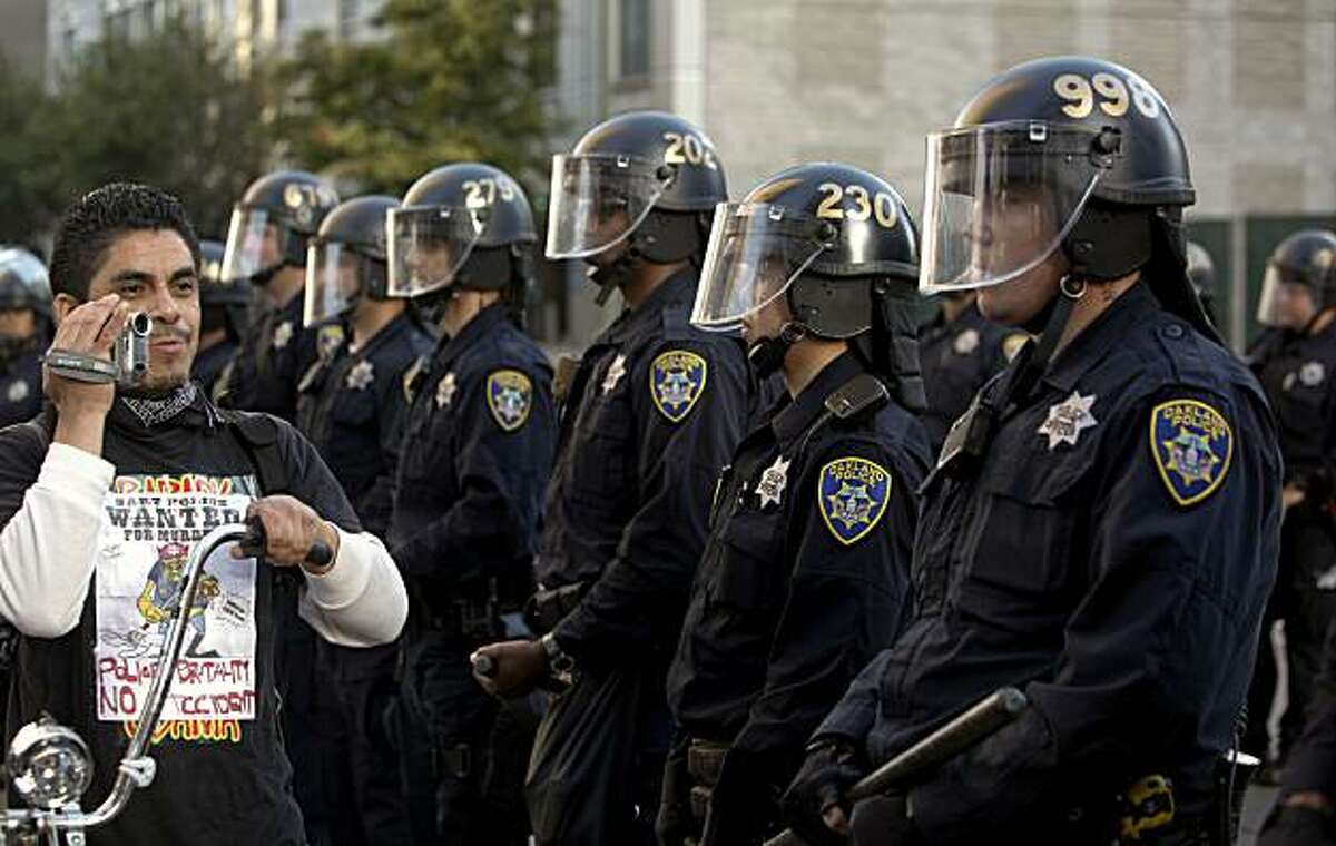 A police line on the corner of Broadway and 12th Street, as protesters gathered in downtown Oakland, Ca., on Thursday July 8, 2010, in support of Oscar Grant, after former BART police officer, Johannes Mehserle, was found guilty of involuntary man slaughter in the killing of Grant.