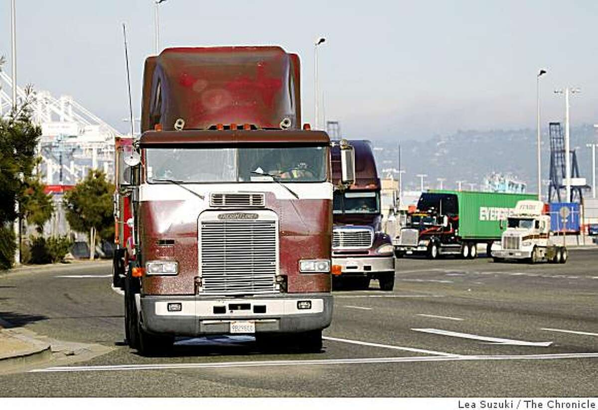 Trucks move along 7th Street in Oakland, Calif. on Monday, December 8, 2008. Drivers and mechanics who work near diesel engines die of lung cancer at high rates, according to a national study of more than 30,000 people released Monday.