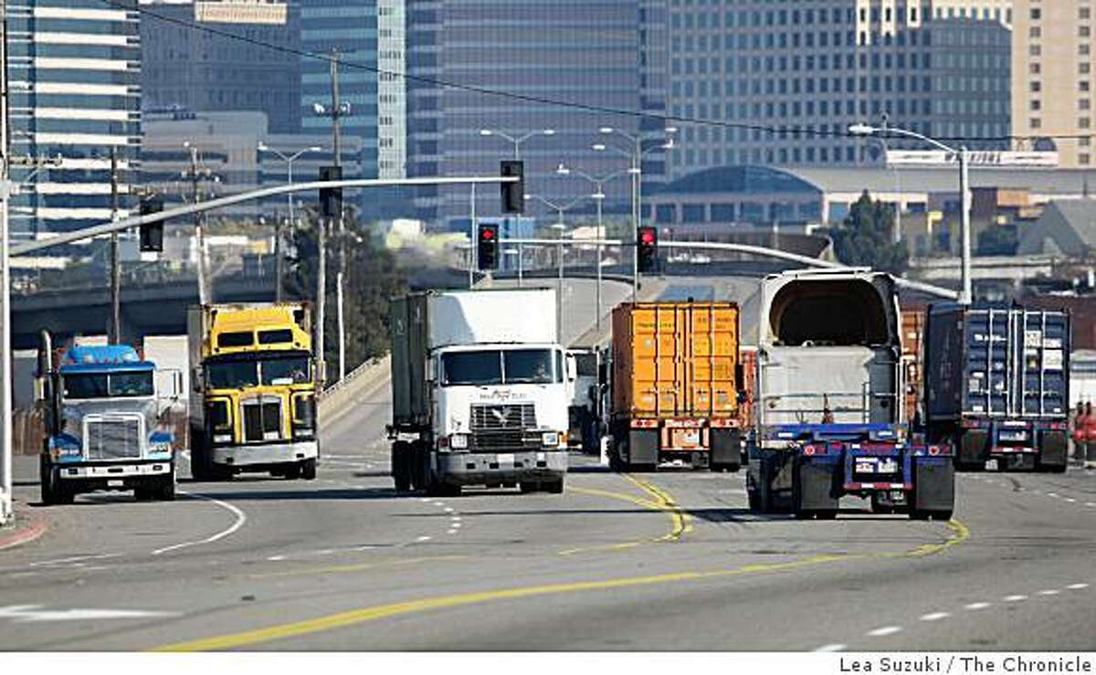 Trucks move along Middle Harbor Road in Oakland, Calif. on Monday, December 8, 2008. Drivers and mechanics who work near diesel engines die of lung cancer at high rates, according to a national study of more than 30,000 people released Monday.