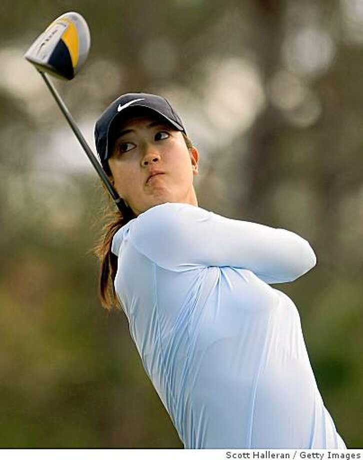 DAYTONA BEACH, FL - DECEMBER 06:  Michelle Wie watches her tee shot on the 12th hole during the fourth round of the LPGA Qualifying School at LPGA International on December 6, 2008 in Daytona Beach, Florida.  (Photo by Scott Halleran/Getty Images) Photo: Scott Halleran, Getty Images