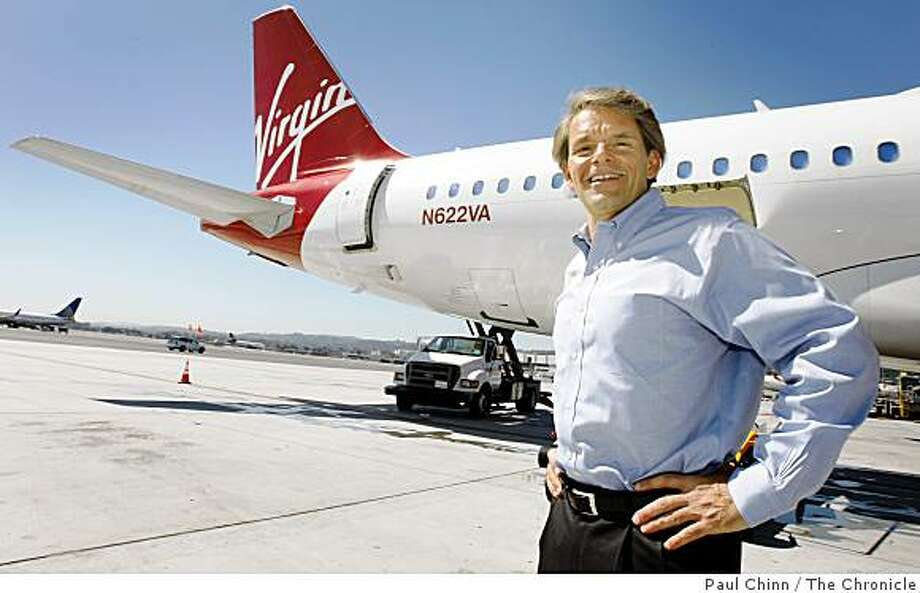 Virgin America Airlines CEO David Cush is seen with a San Diego-bound Airbus A-320 at San Francisco International Airport in San Francisco, Calif., on Friday, May 16, 2008. The start-up airlines is seeking expansion to include flights to Chicago.Photo by Paul Chinn / San Francisco Chronicle Photo: Paul Chinn, The Chronicle