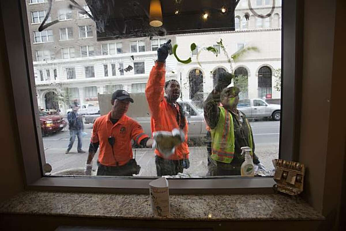 Oakland City workers clean up the aftermath of a protest in downtown Oakland over the involuntary manslaughter conviction of former BART police officer Johannes Mehserle for the shooting death of Oscar Grant, July 9, 2010 in Oakland, California.