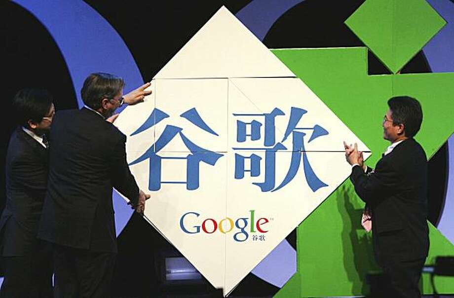 FILE - In this April 12, 2006 file photo, Eric Schmidt, CEO of Google, second left, Kaifu Lee, then Vice President of Google China, left, and Johnny Chou, then President of Google China, right, unveil the Chinese-language Google brand name at a press conference in Beijing. Google said Friday, July 9, 2010 that Beijing has renewed the license it needs to continue operating a website in China. The renewal has been in doubt due to the tense relations between Google and Chinese authorities over censorship ofGoogle search results. Photo: EyePress, Associated Press 2006