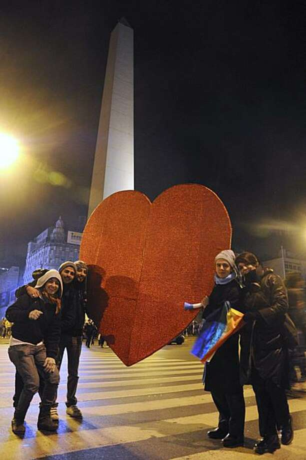 Supporters of same sex marriage hold a heart as they pose in front of Buenos Aires' obelisk early Thursday July 15, 2010 after Argentina legalized same-sex marriage.  Senators voted early Thursday to approve a law allowing same-sex marriage, making Argentina the first in Latin America to grant same-sex marriages all the rights of heterosexual unions. Photo: Rolando Andrade Stracuzi, AP