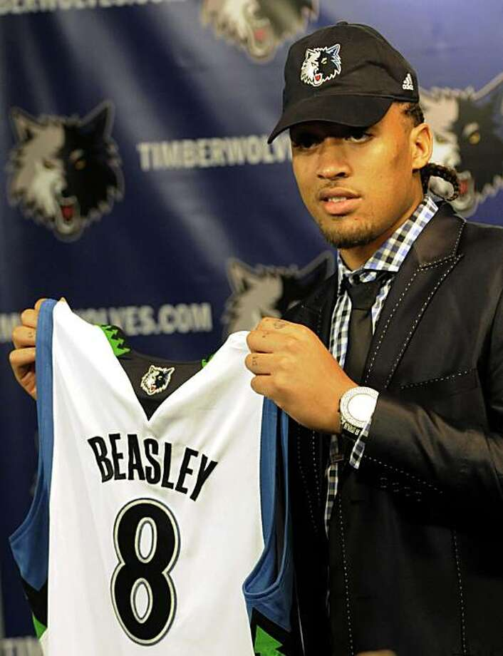 New NBA Minnesota Timberwolves basketball forward Michael Beasley holds up his new jersey number during a news conference Thursday, July 15, 2010 in Minneapolis. Beasley was obtained in a trade with the Miami Heat. Photo: Jim Mone, AP