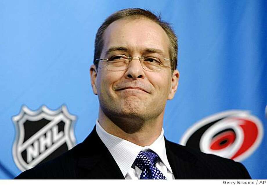 Paul Maurice smiles during a news conference in Raleigh, N.C., Wednesday, Dec. 3, 2008 where he was named head coach of the Carolina Hurricanes by Jim Rutherford, president and general manager. The Hurricanes fired head coach Peter Laviolette Wednesday. Photo: Gerry Broome, AP