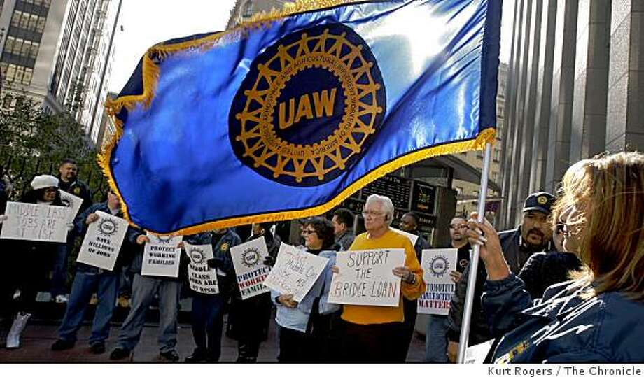 Leticia Quesada from local 2244 in Fremont Ca Jose waves the UAW flag out side Senator Feinstein�s office on Post Street as they call on Congress to help the car companies. on Saturday Dec 6,  2008 in San Francisco, Calif Photo: Kurt Rogers, The Chronicle