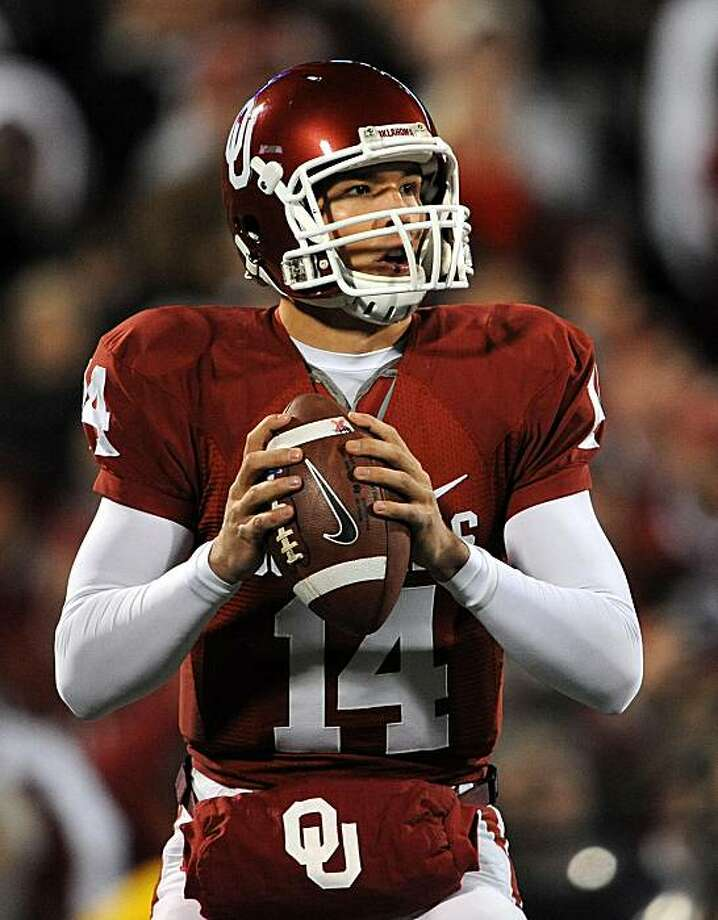 NORMAN, OK - NOVEMBER 22:  Quarterback Sam Bradford #14 of the Oklahoma Sooners drops back to pass against the Texas Tech Red Raiders at Memorial Stadium on November 22, 2008 in Norman, Oklahoma.  (Photo by Ronald Martinez/Getty Images) Photo: Ronald Martinez, Getty Images