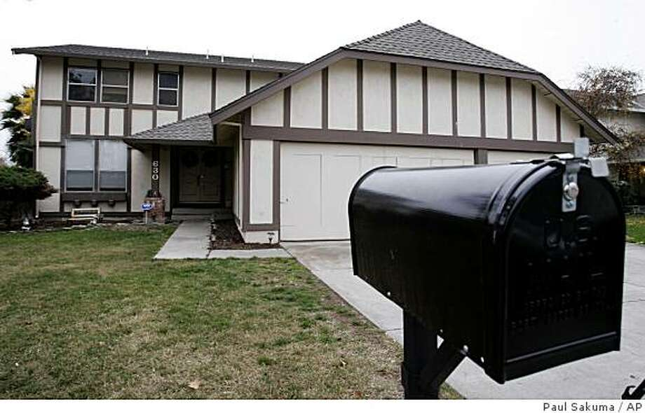 The Tracy, Calif. home where police believe Kelly Layne Lau and Michael Schumacher held a 17 year-old boy captive, is seen Tuesday, Dec. 2, 2008. A Girl Scout leader and her husband were arrested after an emaciated, terrified and nearly naked 17-year-old showed up at a gym with a chain locked to his ankle, saying he had just fled his captors, authorities said Tuesday. (AP Photo/Paul Sakuma) Photo: Paul Sakuma, AP