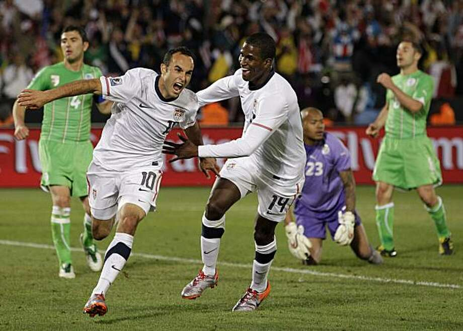 United States' Landon Donovan, foreground left, celebrates after scoring a goal with fellow team member United States' Edson Buddle, foreground right, as Algeria goalkeeper Rais M'Bolhi, second from left in background, reacts during the World Cup group Csoccer match between the United States and Algeria at the Loftus Versfeld Stadium in Pretoria, South Africa, Wednesday, June 23, 2010. Photo: Elise Amendola, AP