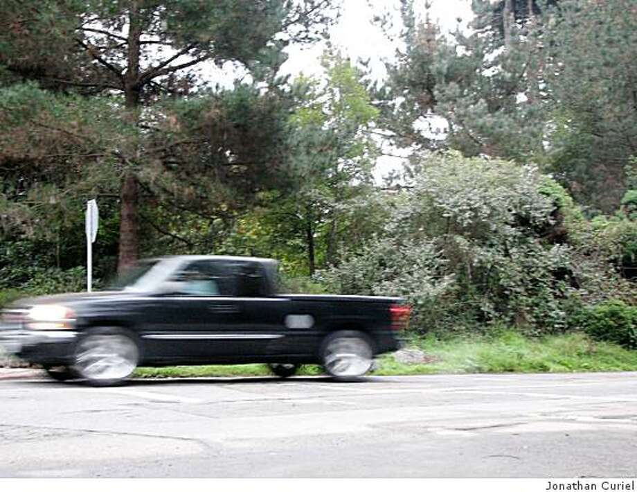 """The intersection in GG Park, where the northbound part of Chain of Lakes  Drive East as it hits the crosswalk that leads to the horse grounds, is missing """"stop"""" lettering on the pavement. Photo: Jonathan Curiel"""