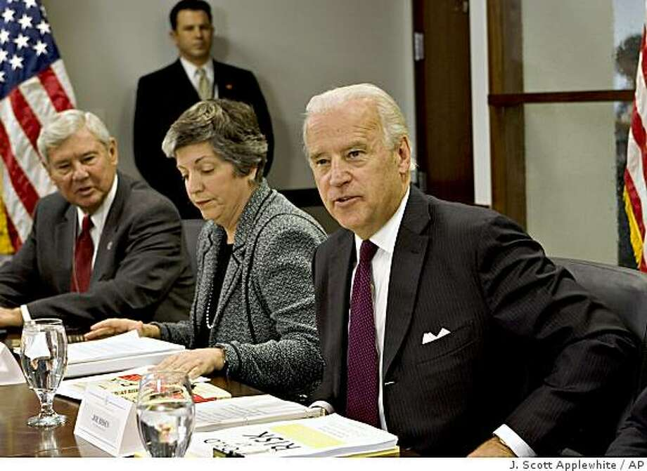 Vice President-elect Joe Biden, right, is briefed on a report from a bipartisan commission that says the United States can expect a terrorist attack using nuclear or biological weapons before 2013, at the presidential transition headquarters in Washington, Wednesday, Dec. 3, 2008.  Left to right are: former Sen. Bob Graham of Florida, who chaired the Commission on the Prevention of WMD Proliferation and Terrorism, Homeland Security Secretary-designate Janet Napolitano of Arizona, and Biden.  (AP Photo/J. Scott Applewhite) Photo: J. Scott Applewhite, AP