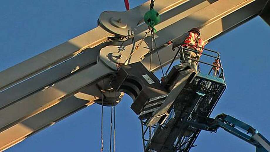In this frame from video provided by Caltrans, construction workers place a buckle over a cracked eyebar on the eastern portion of the Bay Bridge on Monday, September 7, 2009. Repairs continue on a portion of the San Francisco-Oakland Bay Bridge for Labor Day weekend beginning Thursday, September 3, 2009. Photo: Caltrans 2009, The Chronicle