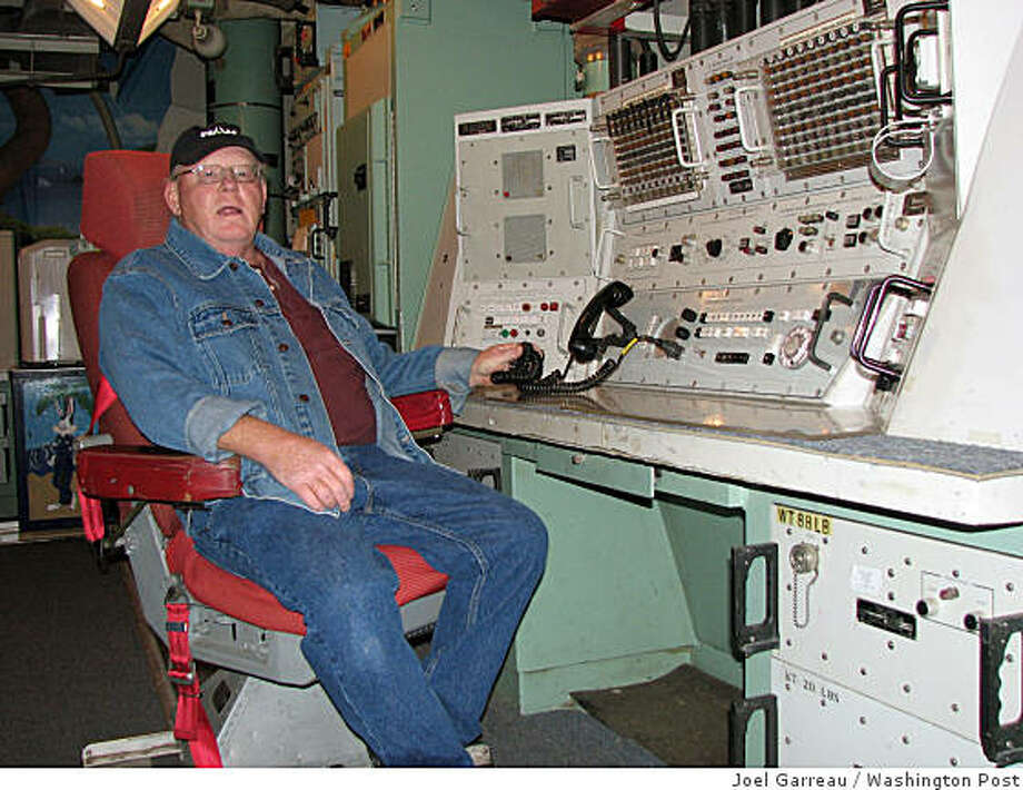 MISSILE: Cooperstown, N.D., native John Clark, at the defunct launch controls, keeps Oscar Zero in the same condition it was when it closed July 17, 1997. Deep within the missile silo, Oscar Zero has been preserved in the hope that North Dakota's State Historical Society will reopen it as a museum. Illustrates MISSILE (category a), by Joel Garreau (c) 2008, The Washington Post. Moved Monday, Nov. 24, 2008. (MUST CREDIT: Washington Post photo by Joel Garreau) Cooperstown, N.D., native John Clark, at the defunct launch controls, keeps Oscar Zero in the same condition it was when it closed July 17, 1997. Deep within the missile silo, Oscar Zero has been preserved in the hope that North Dakota's State Historical Society will reopen it as a museum. Illustrates MISSILE (category a), by Joel Garreau (c) 2008, The Washington Post. Moved Monday, Nov. 24, 2008. (MUST CREDIT: Washington Post photo by Joel Garreau) Photo: Joel Garreau, Washington Post