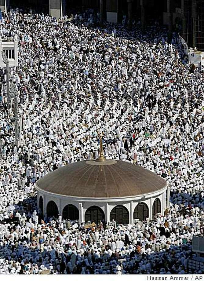 Muslim pilgrims pray during Friday prayers inside the Grand mosque in Mecca, Saudi Arabia, Friday, Dec. 5, 2008.  Muslim pilgrims flooded into the holy city of Mecca in preparation for the annual hajj, which officially starts Saturday, and is one of the five pillars of Islam, alongside belief in God, praying, fasting and charity.  (AP Photo/Hassan Ammar) Photo: Hassan Ammar, AP