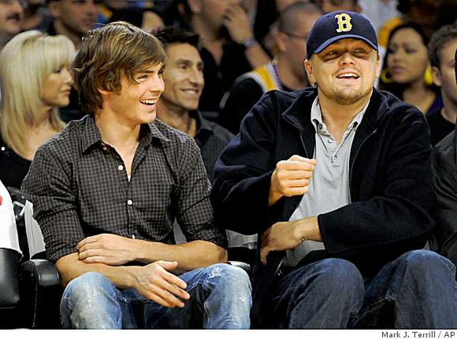Actors Zac Efron, left, and Leonardo DiCaprio watch the Denver Nuggets play the Los Angeles Lakers in an NBA basketball game, Friday, Nov. 21, 2008, in Los Angeles.  (AP Photo/Mark J. Terrill) Photo: Mark J. Terrill, AP