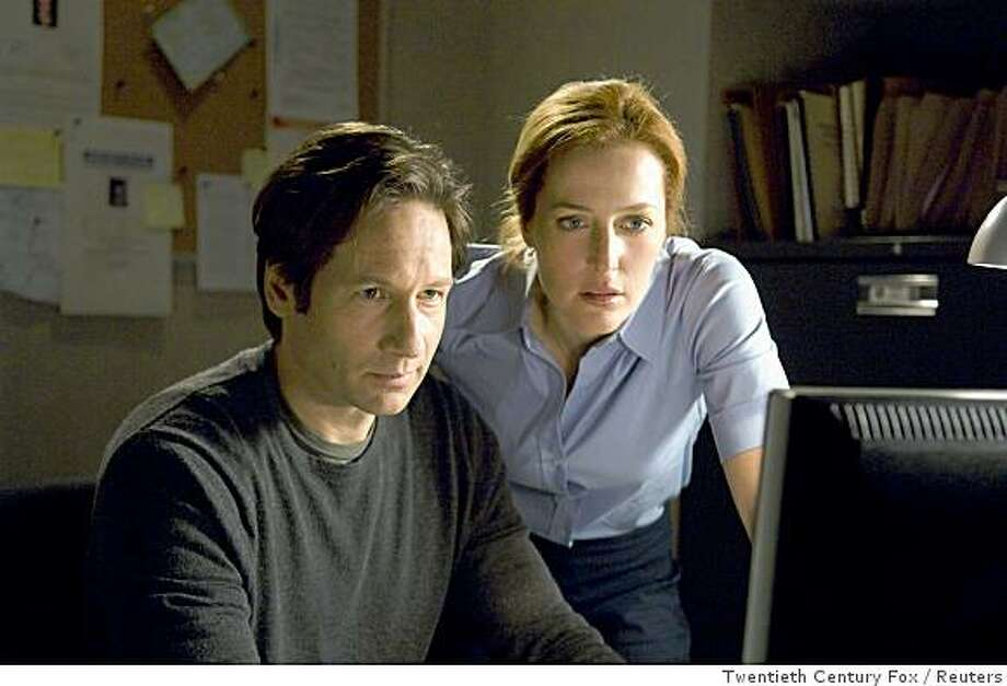 """Actors David Duchovny (L) and Gillian Anderson are shown in this undated publicity photo released to Reuters April 23, 2008 in a scene from Twentieth Century Fox upcoming film """"X-Files: I Want to Believe"""". With the summer movie season set to begin with next week's release of comic book movie """"Iron Man,"""" Hollywood is holding its breath, hoping for a big start to the lucrative moviegoing period.    REUTERS/Diya Pera/Twentieth Century Fox/Handout      (UNITED STATES).  NO SALES. NO ARCHIVES. FOR EDITORIAL USE ONLY. NOT FOR SALE FOR MARKETING OR ADVERTISING CAMPAIGNS. Photo: Twentieth Century Fox, Reuters"""