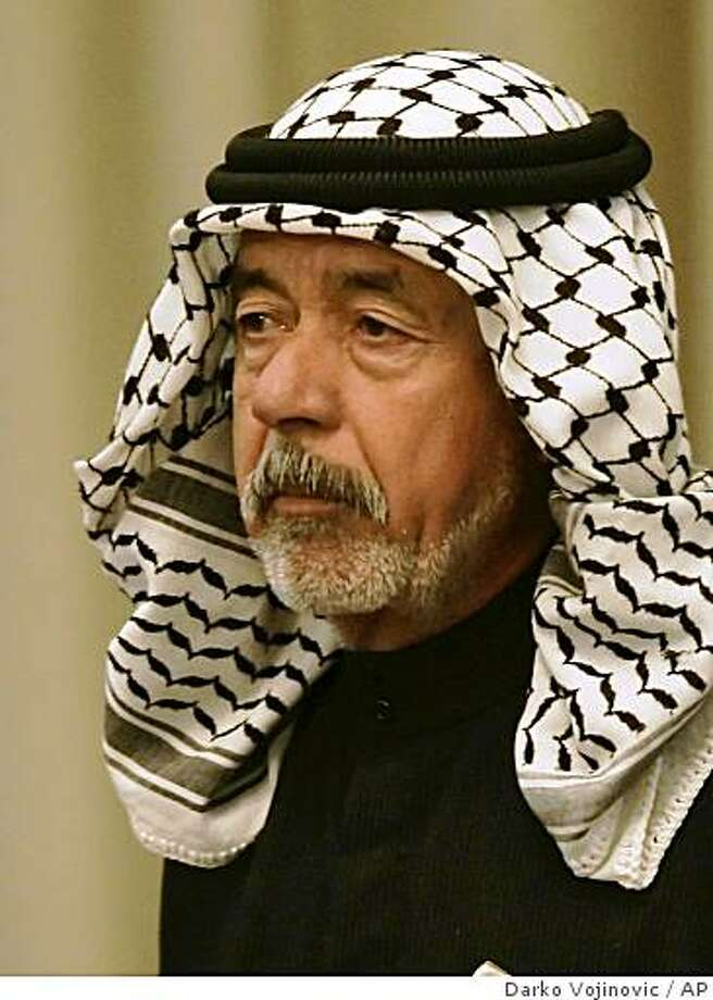 "*** FILE ***  In this Jan. 8, 2007 file photo, Saddam Hussein's cousin Ali Hassan al-Majid, known as ""Chemical Ali,"" for his alleged use of chemical weapons against Iraqi Kurds, listens to prosecution evidence during the Operation Anfal trial, in Baghdad, Iraq. A special Iraqi court has sentenced Saddam Hussein's cousin, known as ""Chemical Ali,"" to death for his role in the 1991 suppression of a Shiite uprising Tuesday, Dec, 2, 2008. Ali Hassan al-Majid already faces death by hanging after being convicted last year for his role in the killing of tens of thousands of Kurds in a crackdown in the late 1980s. But that execution has been delayed by legal wrangling.  (AP Photo/Darko Vojinovic, Pool) Photo: Darko Vojinovic, AP"