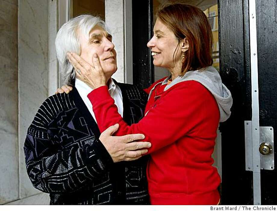 Donaa and William hugged before going back into their apartment after a walk. Season of Sharing helped Donaa and William O'Brien after William suffered a stroke.  His wife Donaa walked with him in the Tenderloin Thursday, November 20, 2008. Photo: Brant Ward, The Chronicle