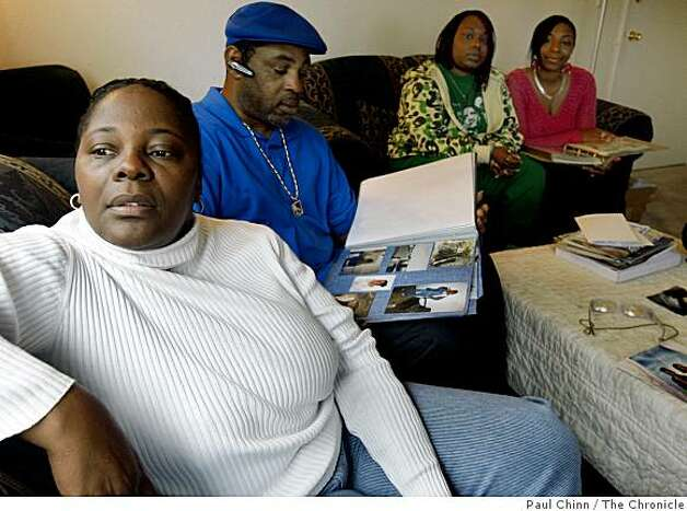 Carol Frazier, left, pauses while looking at photo albums with family at her home in Vallejo, Calif., on Wednesday, Nov. 26, 2008. Frazier's daughter Taneka Talley was fatally stabbed to death in 2006 but Talley's insurance company is refusing to pay benefits to her son claiming the murder was racially motivated. Seated next to Frazier is Talley's father and Frazier's other daughters Taneya and Shameana, far right. Photo: Paul Chinn, The Chronicle