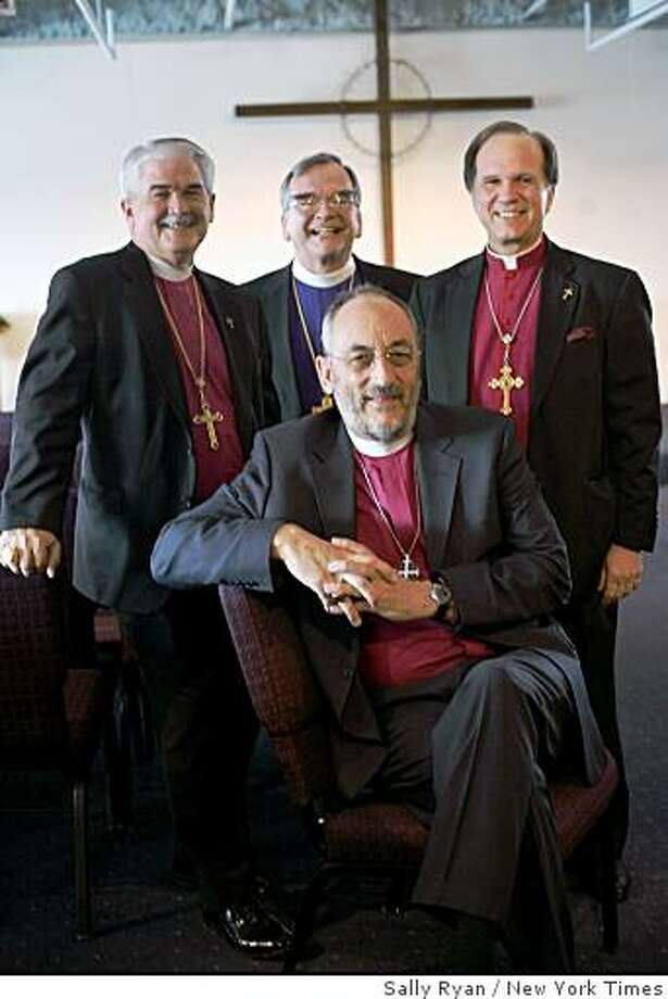 Conservative Episcopal leaders pose for a photograph after a meeting in West Chicago, Ill., on Wednesday, Dec. 3, 2008. Standing, from left: Bishop Jack Iker of Ft. Worth, Texas; Bishop Robert Duncan of Pittsburgh; and Bishop Keith Ackerman, president of Forward in Faith North America. Bishop Martyn Minns is seated in front.Conservatives disaffected with the Episcopal Church met on Wednesday to found their own rival Anglican province in North America, the biggest challenge yet to the authority of the church in a five-year battle over the ordination of an openly gay bishop. Photo: Sally Ryan, New York Times