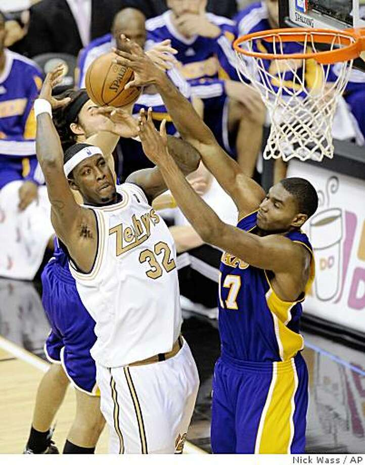 Washington Wizards' Andray Blatche (32) goes to the basket against Los Angeles Lakers' Andrew Bynum (17) during the fourth quarter of an NBA basketball game, Friday, Dec. 5, 2008, in Washington. The Wizards are wearing the throwback Chicago Zephyrs jerseys that they wore for the 1962-63 season before moving to Baltimore and adopting the Bullets nickname in 1963-64. The Lakers won 106-104.(AP Photo/Nick Wass) Photo: Nick Wass, AP