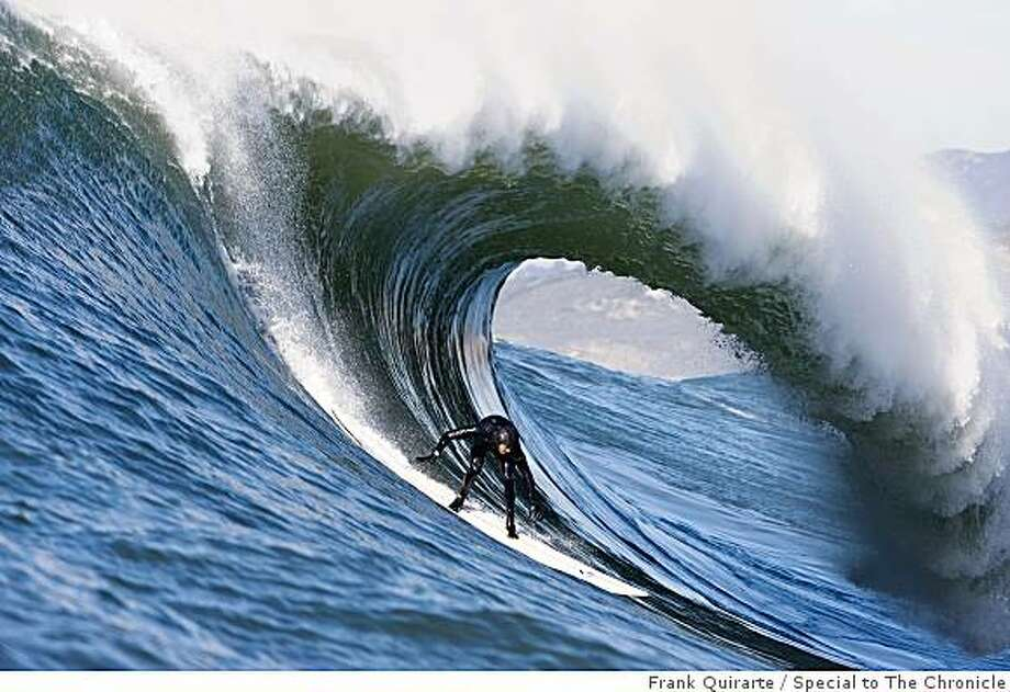 Derek Dunfee surfs the waves at Maverick's, the famed spot near Half Moon Bay, Calif., on Nov. 30, 2008. Photo: Frank Quirarte, Special To The Chronicle