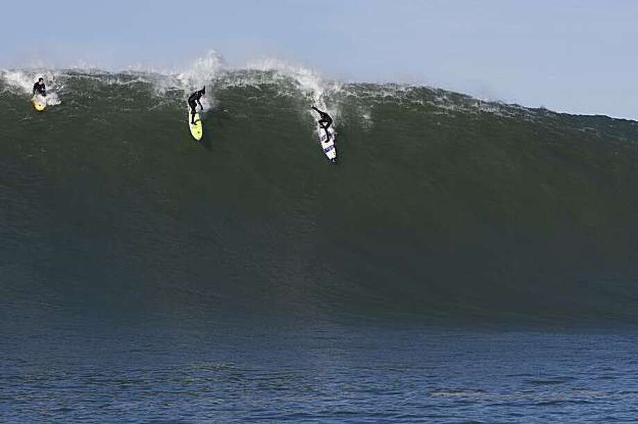 Grant Baker (right) surfs the waves at Maverick's, the famed spot near Half Moon Bay, Calif., on Nov. 30, 2008. Photo: Frank Quirarte, Special To The Chronicle