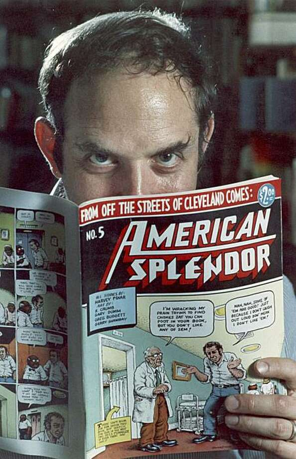 """In this 1986 file photo comic-book writer Harvey Pekar poses with a copy of his """"American Splendor"""" in his Cleveland Heights, Ohio home. Pekar, whose comic was made into a 2003 film starring Paul Giammati, was been found dead in his Ohio home early Monday, July 12, 2010. Photo: Mark Duncan, AP"""