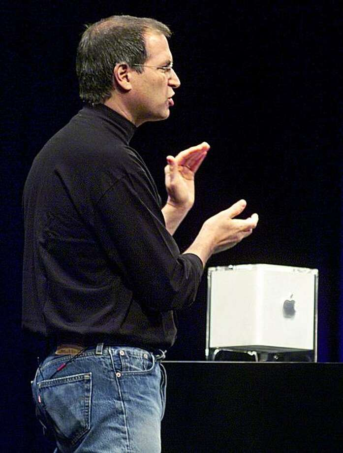 Apple CEO Steve Jobs unveils the Power Macintosh G4 Cube during an Apple conference in New York City in 2000. (AP Photo/Richard Drew) Photo: Richard Drew, AP