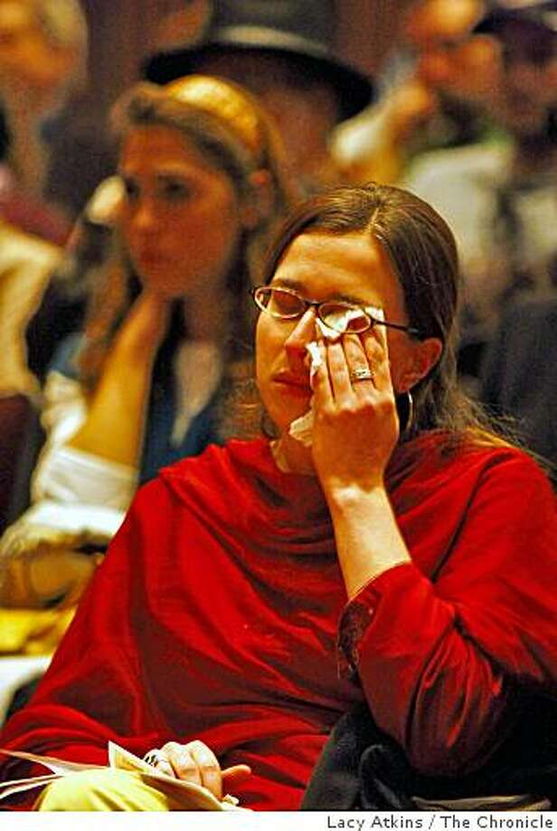 Jocelyn Berger wipes her tears as people tell of their memories of those who were killed in Mumbai, during a gathering at the Jewish Community Center, Tuesday Dec. 2, 2008, in San Francisco, Calif., to honor the members of the Chabad that were killed in the terrorist attacks in Mumbai. Photo: Lacy Atkins, The Chronicle